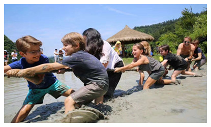 Tourists from France  attend farm activities in Zhangjiajie